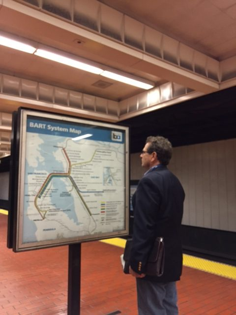 Paul Fadelli looking at a BART map in the BART station