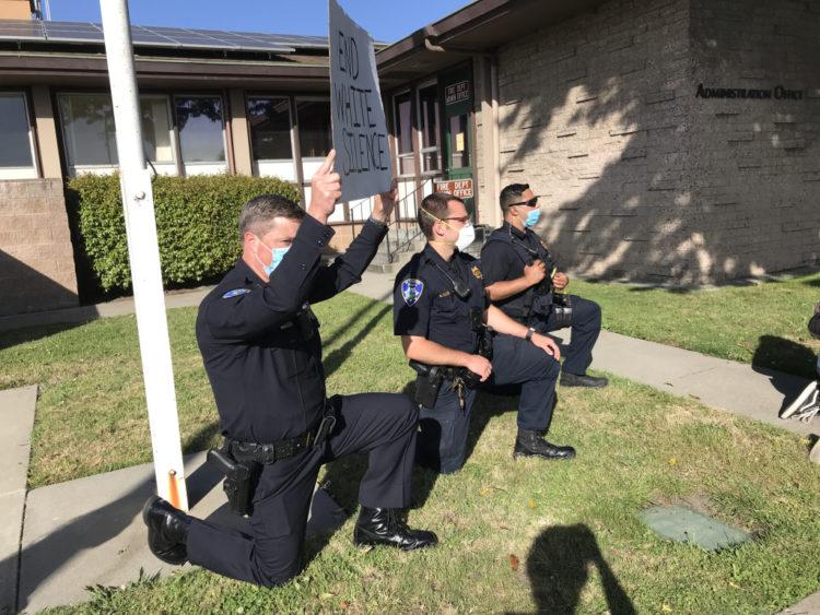 Police kneeling